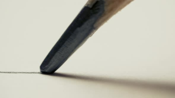 Graphite Pencil Draws a Straight Line on a White Background Paper, Macro Shot