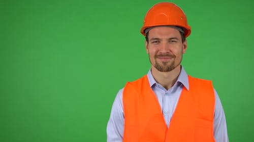 A Young Handsome Construction Worker Shows a Thumb Up To the Camera with a Smile - Green Screen