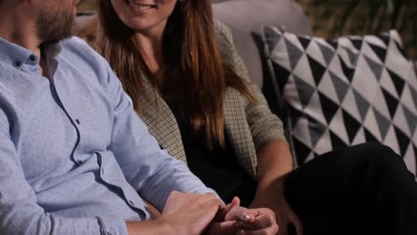 Thumbnail for Happy Couple Sitting Holding Hands at Psychologist