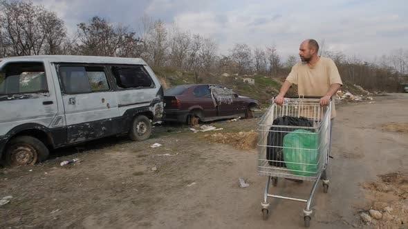 Thumbnail for Homeless Mature Man Pushing Cart at Garbage Dump