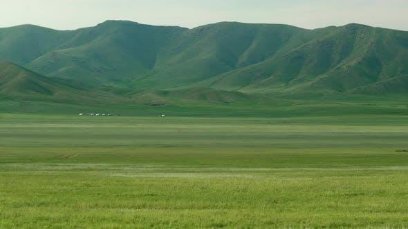 Mongolian Ger Yurts in Treeless Meadow