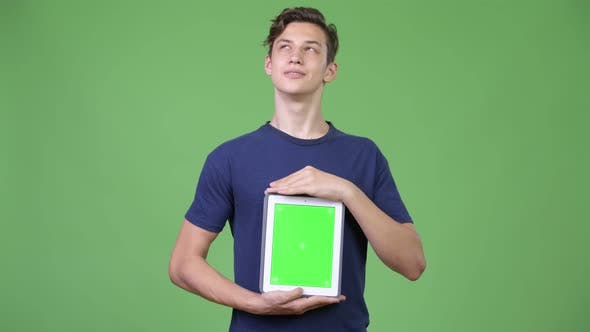 Thumbnail for Young Handsome Teenage Boy Showing Digital Tablet