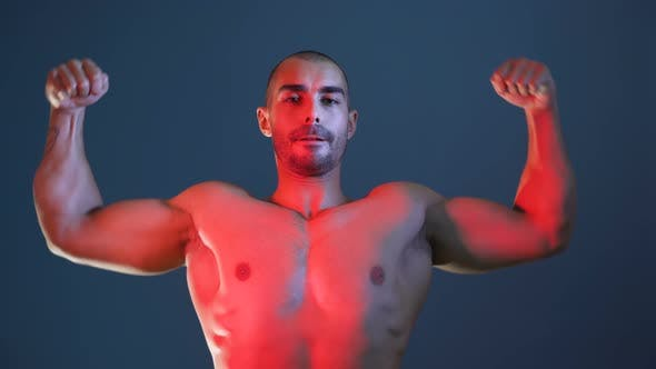 Thumbnail for Male Fitness Model Showing Muscular Arms, Chest and Shoulders, Posing for Photo Session