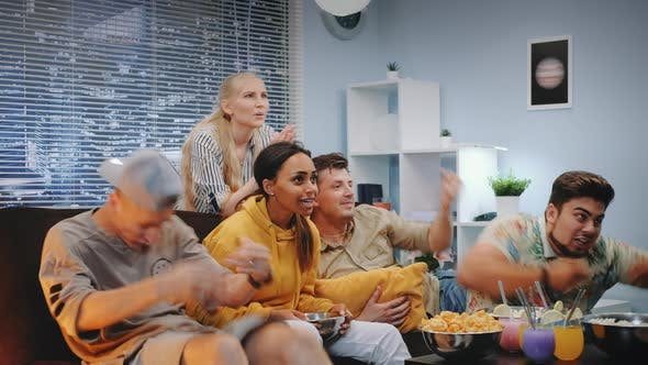 Thumbnail for Happy Viewers Watching Sports on TV and Spilling Popcorn When Team Scores