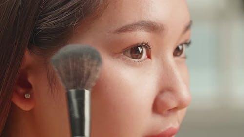 Asian Girl Makeup Applying Closeup. Cosmetic Powder Brush