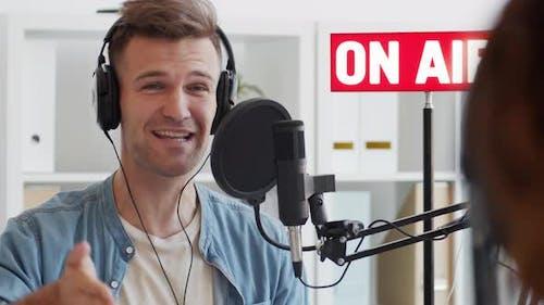 Host Introducing Interlocutor on Radio
