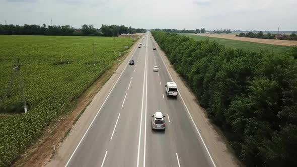 Thumbnail for Aerial Fly Over Motorway, Freeway Traffic - Trucks and Cars on the Road