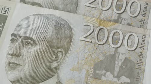 Close-up paper banknotes of Serbia on table  4K 2160p 30fps UltraHD tilting footage - Two thousand S