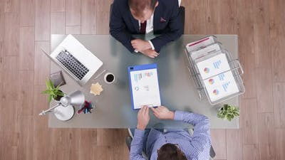 Top View of Businessman in Suit Shaking Hands with Manager