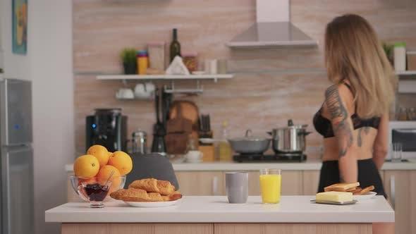 Lady in Lingerie Preparing Breakfast