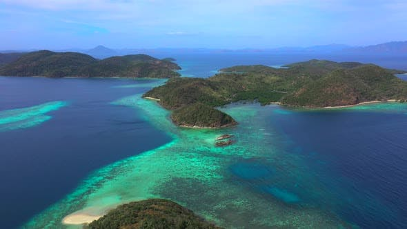 Cover Image for Panorama of Tropical Islands Surrounded By Turquoise Sea. Camera Move Back