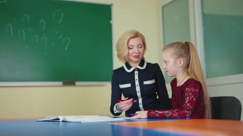 Female tutor with a little girl