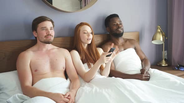 Diverse Trio Watches TV in the Bedroom.