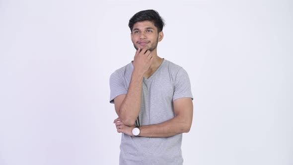 Thumbnail for Young Happy Bearded Indian Man Smiling While Thinking