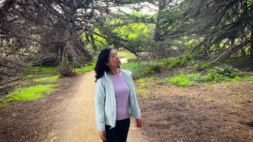 Asian Woman Hiking In Big Sur California
