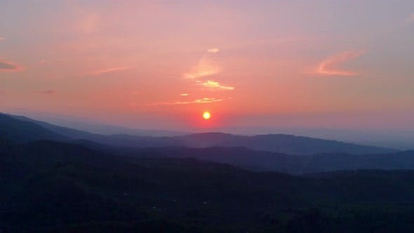 Cover Image for Sunsets Behind the Mountains