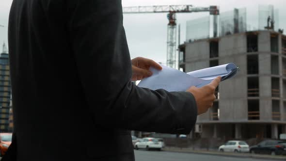 Thumbnail for Project Manager Checking Construction Plan
