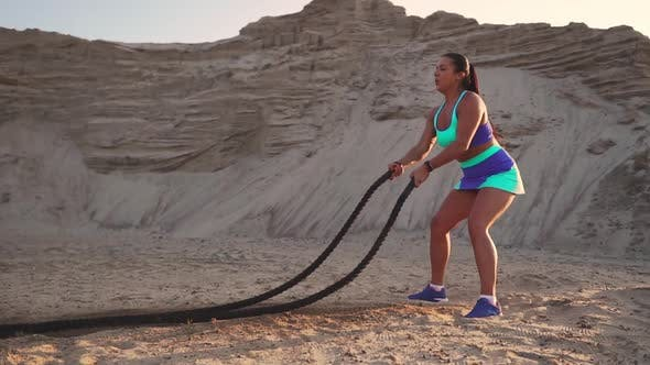 Thumbnail for Athletic Woman Doing Crossfit Exercises with a Rope Outdoor