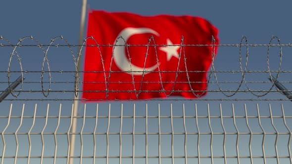 Cover Image for Barbed Wire Against Waving Flag of Turkey