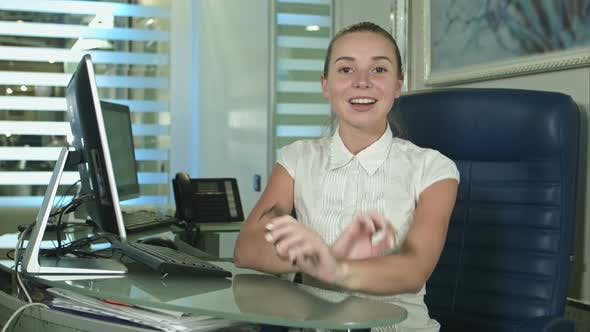 Thumbnail for Cheerful Office Assistant Talking To a Camera
