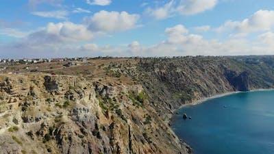 Aerial View of Waves Crashing Against Rocks