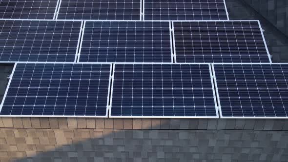 Aerial Drone Shot of Photovoltaic Solar Panels on the Roof of a Building for Renewable Energy