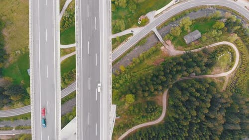 Aerial Top View of Highway Viaduct with Multilane Traffic in Mountains. Autobahn in Austria