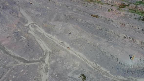 Thumbnail for Mining Dump Trucks in Large Granite Open Pit Mine. Drone High Top View