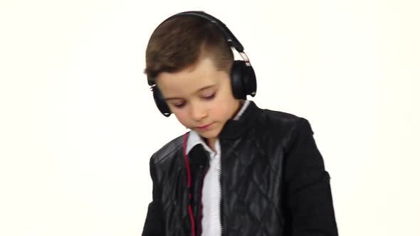 Thumbnail for Smiling Boy Dj in Headphones Playing on Vinyl. Slow Motion