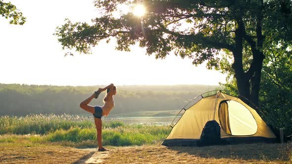 Thumbnail for Woman Doing Yoga in a Front of Tent