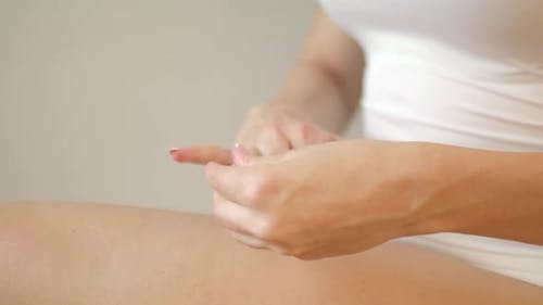 Woman Applying Moisturizing Cream on Her Hands. Skin Care and Anti Aging Concept