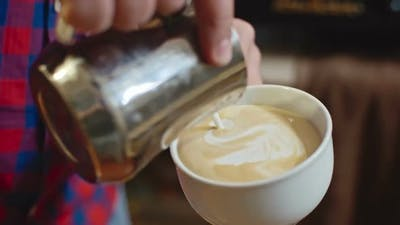 Barista Performing Latte Art